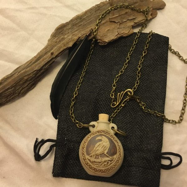 Raven pendant with bag